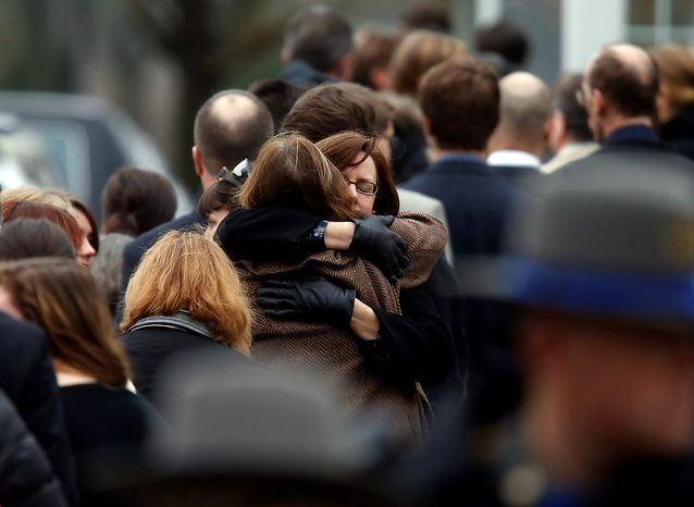 Mourners arrive at a funeral service for 6-year-old Noah Pozner, Monday, Dec. 17, 2012, in Fairfield, Conn.  Pozner was killed when a gunman walked into Sandy Hook Elementary School in Newtown Friday and opened fire, killing 26 people, including 20 children. (AP Photo/Jason DeCrow)