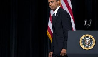 ** FILE ** President Obama walks off stage after delivering a speech at an interfaith vigil for the victims of the Sandy Hook Elementary School shooting on Sunday, Dec. 16, 2012, at Newtown High School in Newtown, Conn. (AP Photo/Evan Vucci)