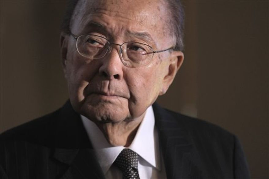 ** FILE ** In this Monday, Sept. 19, 2011 photo, Sen. Daniel K. Inouye, Hawaii Democrat, president pro temper of the Senate, and a recipient of the Medal of Honor, attends a ceremony on Capitol Hill in Washington, where he is presented a commemorative coin marking the 150th anniversary of the creation of the Medal of Honor by Congress. Inouye died of respiratory complications, Monday, Dec. 17, 2012. He was 88. (AP Photo/J. Scott Applewhite, File)