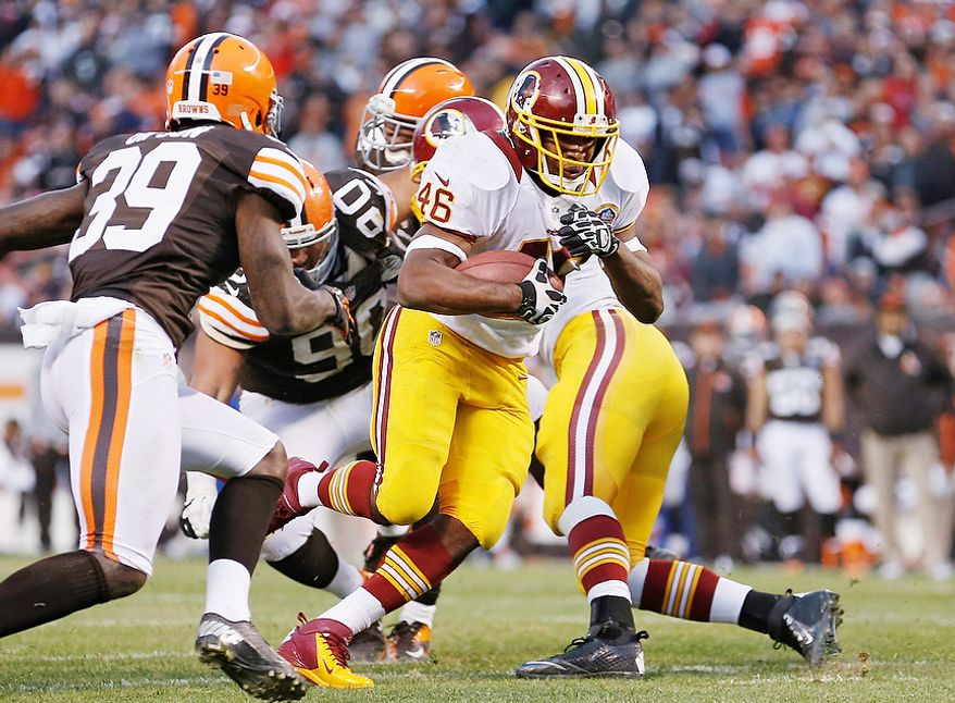 Washington Redskins running back Alfred Morris (46) breaks past Cleveland Browns cornerback Tashaun Gipson (39) on an 8-yard touchdown run in the fourth quarter of an NFL football game in Cleveland, Sunday, Dec. 16, 2012. (AP Photo/Rick Osentoski)