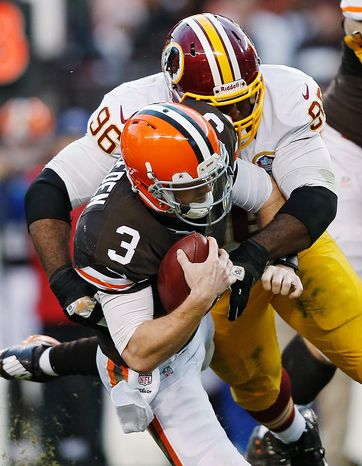 Washington Redskins nose tackle Barry Cofield (96) sacks Cleveland Browns quarterback Brandon Weeden in the fourth quarter of an NFL football game in Cleveland, Sunday, Dec. 16, 2012. The Redskins won 38-21. (AP Photo/Rick Osentoski)