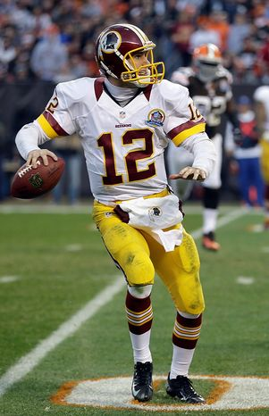 Washington Redskins quarterback Kirk Cousins looks for an open receiver in the third quarter of an NFL football game against the Cleveland Browns, Sunday, Dec. 16, 2012, in Cleveland. (AP Photo/Tony Dejak)