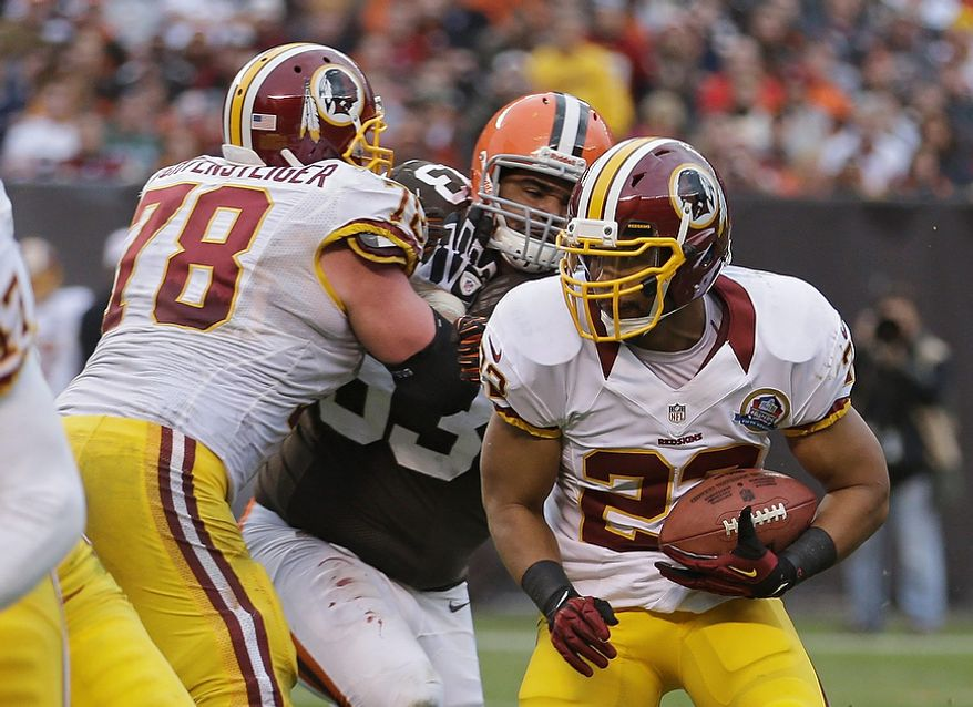 Washington Redskins running back Evan Royster (22) breaks away on a 4-yard touchdown run against the Cleveland Browns in the fourth quarter of an NFL football game on Sunday, Dec. 16, 2012, in Cleveland. (AP Photo/Tony Dejak)