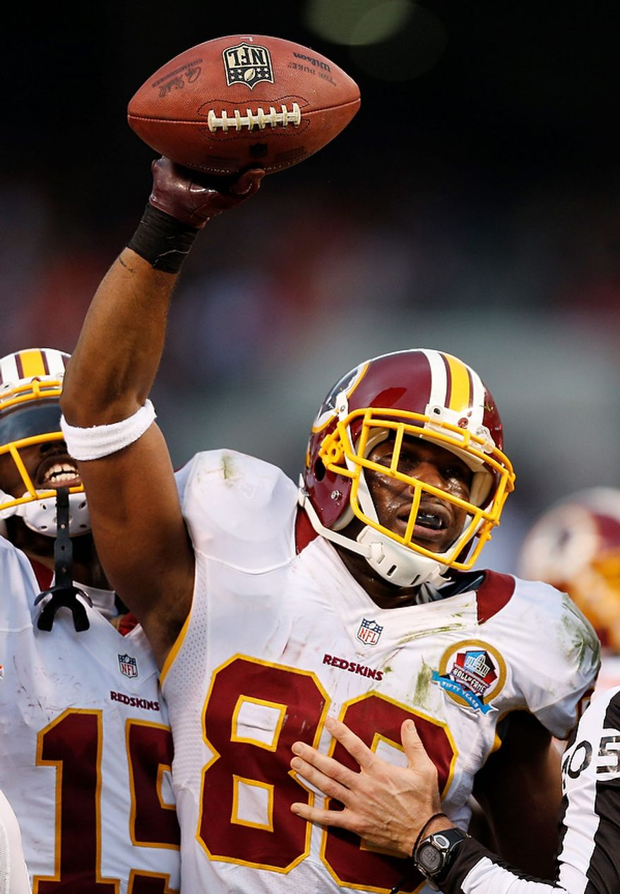 Washington Redskins wide receiver Pierre Garcon celebrates after recovering a fumble by teammate Santana Moss in the fourth quarter of an NFL football game against the Cleveland Browns in Cleveland, Sunday, Dec. 16, 2012. (AP Photo/Rick Osentoski)
