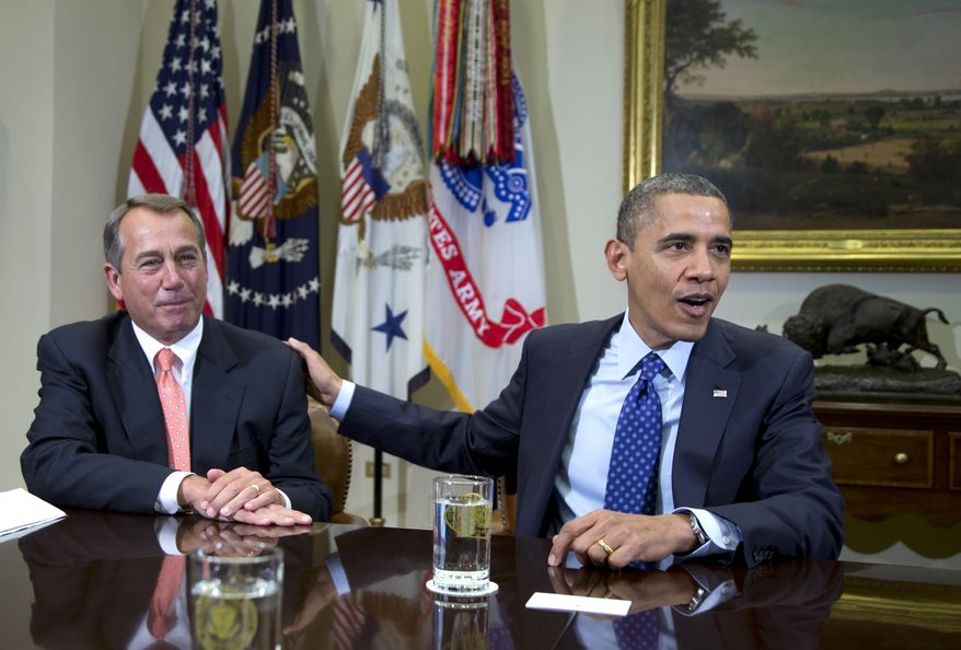 ** FILE ** President Obama acknowledges House Speaker John A. Boehner, Ohio Republican, while speaking to reporters in the Roosevelt Room of the White House in Washington on Sunday, Nov. 16, 2012, as he hosts a meeting of the bipartisan, bicameral leadership of Congress to discuss the deficit and the economy. (AP Photo/Carolyn Kaster)