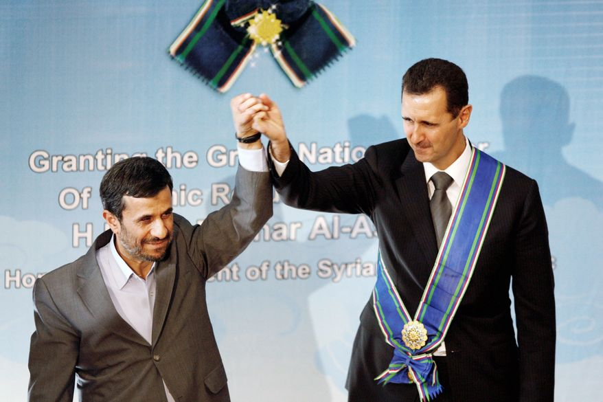 Iran seems to understand it cannot hang its entire strategy on the survival of Syrian President Bashar Assad (wearing sash next to Iranian President Mahmoud Ahmadinejad) and needs to build new alliances as contingencies. Iran has proposed a plan for elections in Syria for parliament and president. (Associated Press)