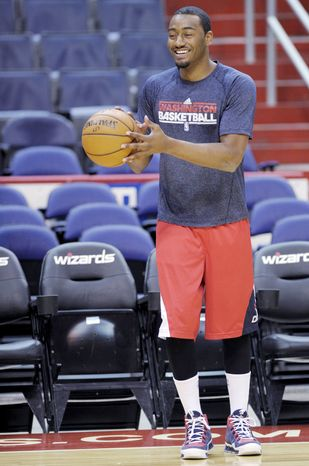 Washington Wizards point guard John Wall, should his left knee not heal in the next several weeks, might be better served by not suiting up this season. (Associated Press)