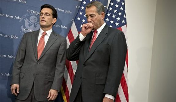 Speaker of the House John Boehner, R-Ohio, right, and House Majority Leader Eric Cantor, R-Va., left, pause before making remarks to reporters about the fiscal cliff negotiations after a Republican strategy session at the Capitol in Washington, Tuesday, Dec. 18, 2012.  (AP Photo/J. Scott Applewhite)