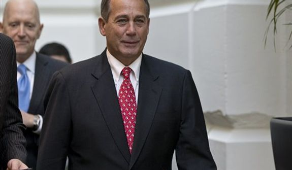 Speaker of the House John Boehner, R-Ohio, arrives for a closed-door meeting with House Republicans as he negotiates with President Obama to avert the fiscal cliff, at the Capitol in Washington, Tuesday, Dec. 18, 2012.   (AP Photo/J. Scott Applewhite)