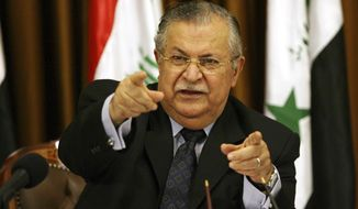 Iraqi President Jalal Talabani talks to reporters in Baghdad in 2007. (AP Photo/Hadi Mizban)