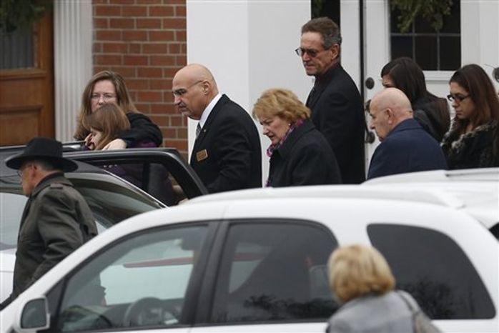 Mourners arrive at St. Rose of Lima Roman Catholic Church during funeral services for James Mattioli, Tuesday, Dec. 18, 2012, in Newtown, Conn. Mattioli, 6, was killed when Adam Lanza walked into Sandy Hook Elementary School in Newtown, Conn., Dec. 14,  and opened fire, killing 26 people, including 20 children, before killing himself.  (AP Photo/Julio Cortez)