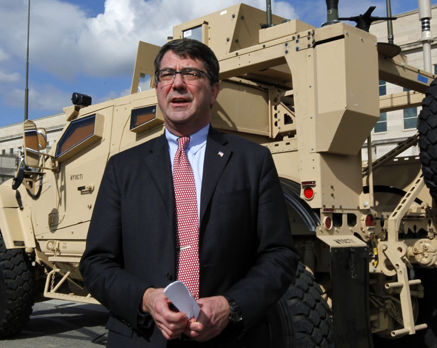 Deputy Defense Secretary Ashton Carter stands in front of a MRAP all-terrain vehicle (M-ATV) at the Pentagon in 2009. (AP Photo/Manuel Balce Ceneta)