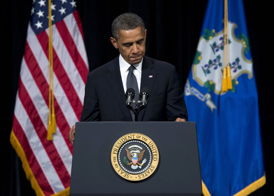 President Barack Obama pauses during a speech at an interfaith vigil for the victims of the Sandy Hook Elementary School shooting on Sunday, Dec. 16, 2012 at Newtown High School in Newtown, Conn. A gunman walked into Sandy Hook Elementary School Friday and opened fire, killing 26 people, including 20 children. (AP Photo/ Evan Vucci)