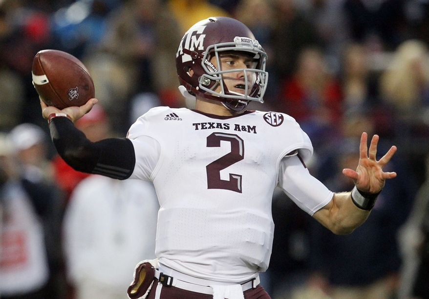 FILE - In this Oct. 6, 2012, file photo, Texas A&M quarterback Johnny Manziel throws a pass in the first quarter of an NCAA college football game against Mississippi in Oxford, Miss. Manziel has become the first freshman to be voted The Associated Press Player of the Year in college football, Tuesday, Dec. 18, 2012.  (AP Photo/Rogelio V. Solis, File)
