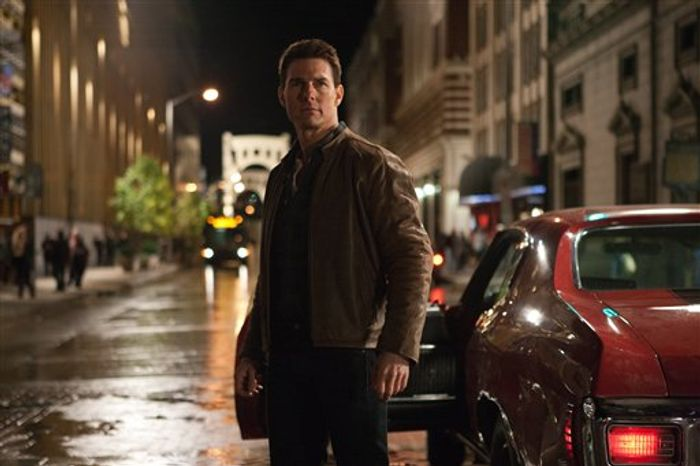 """** FILE ** This publicity film image released by Paramount Pictures shows Tom Cruise in a scene from """"Jack Reacher."""" Cruise plays a former military cop investigating a sniper case. The Film Society of Lincoln Center in New York canceled Monday's Dec. 17, 2012 screening of Tom Cruise's violent new movie, """"Jack Reacher,"""" that was to include a conversation with the actor. A scheduled premiere of the movie in Pittsburgh had also been postponed over the weekend. (AP Photo/Paramount Pictures, File)"""