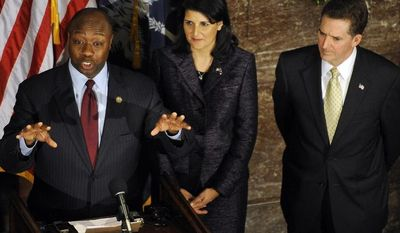 U.S. Rep. Tim Scott, left, speaks during a news conference as South Carolina Gov. Nikki Haley and Sen. Jim DeMint look on at the Statehouse on Monday, Dec. 17, 2012, in Columbia, S.C. Scott was named as DeMint's replacement in the U.S. Senate. (AP Photo/Rainier Ehrhardt)