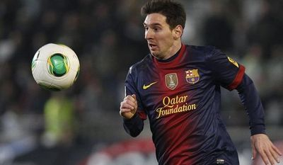 Barcelona's Lionel Messi follows the ball during the 1st leg of a last-16 Copa del Rey soccer match against Cordoba at Arcangel stadium in, Córdoba, Spain on Wendesday, Dec. 12, 2012. (AP Photo/Angel Fernandez)