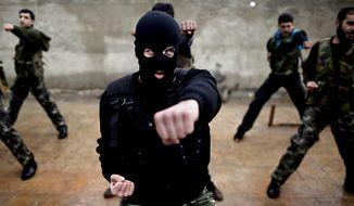 ** FILE ** Syrian rebels attend a training session in Maaret Ikhwan, near Idlib, Syria, Dec. 2012. (AP Photo/Muhammed Muheisen)