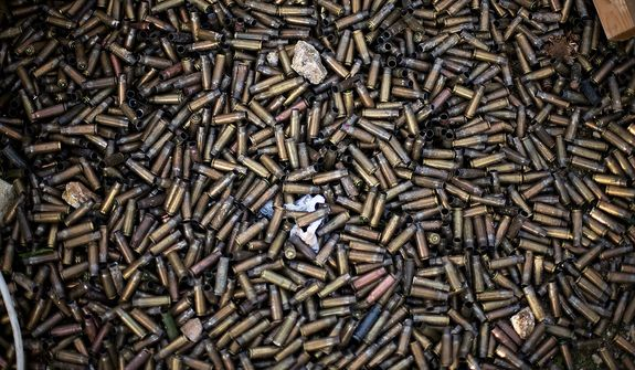 Machine gun rounds are seen near to a Syrian Army trench after heavy clashes with government forces at a military academy besieged by the rebels in Tal Sheer, Syria, Sunday, Dec 16, 2012. (AP Photo / Manu Brabo)
