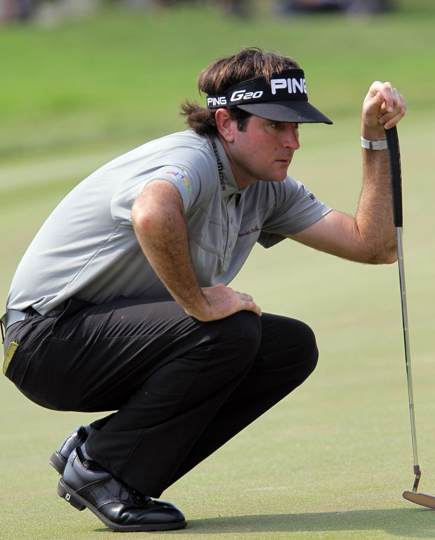 Bubba Watson of the U.S. checks his putting line during the third round of the Thailand Golf Championship at the Amata Spring Country Club in Chonburi province, southeastern Thailand Saturday, Dec. 8, 2012.(AP Photo/Sakchai Lalit)