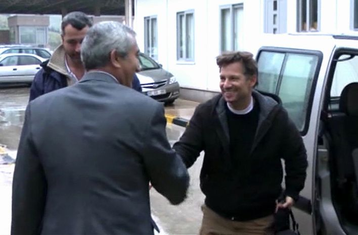 """NBC Chief Foreign Correspondent Richard Engel (right) shakes hands with an unidentified man in Cilvegozu, Turkey, on Tuesday, Dec. 18, 2012, after crossing the border from Syria, where he and his crew were kidnapped by gunmen. Mr. Engel told the Turkish news agency Anadolu that he and his colleagues were """"very happy to be out"""" and they were """"very tired."""" (AP Photo/Anadolu via Associated Press TV)"""