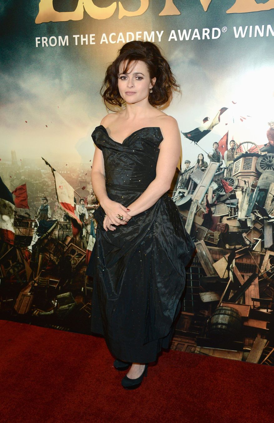 Actress Helena Bonham Carter poses for a photograph as she arrives at the after party for the premiere of Les Miserables at the Roundhouse, London, Wednesday, Dec. 5, 2012. (Photo by Jon Furniss/Invision/AP)