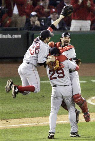 Red Sox celebrate a curse lifted in 2004. (AP Photo/Sue Ogrocki, File)