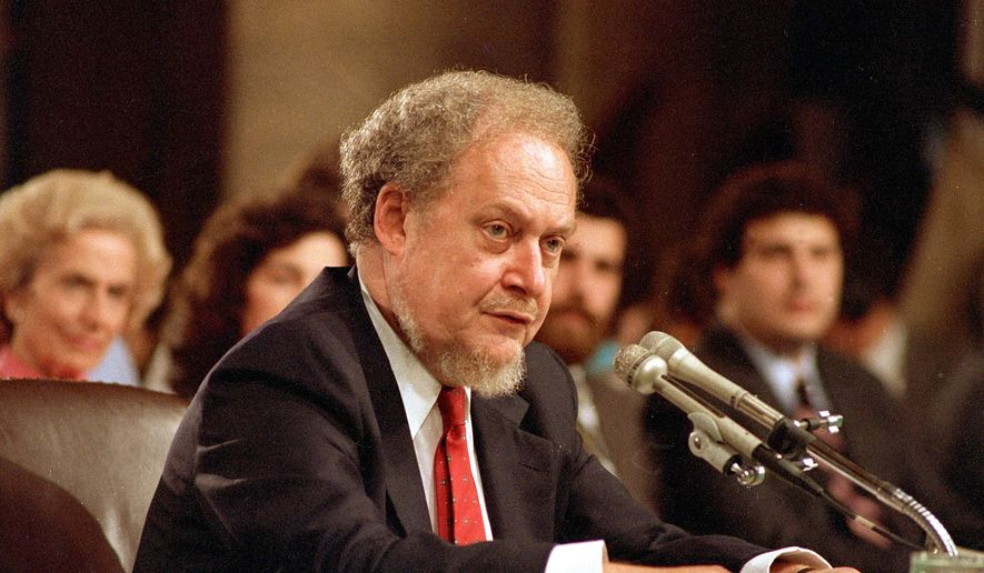In this Sept. 16, 1987, file photo, U.S. Supreme Court nominee Robert H. Bork testifies before the Senate Judiciary Committee during his confirmation hearings on Capitol Hill. Bork's failed Supreme Court nomination made history. (AP Photo/Charles Tasnadi)
