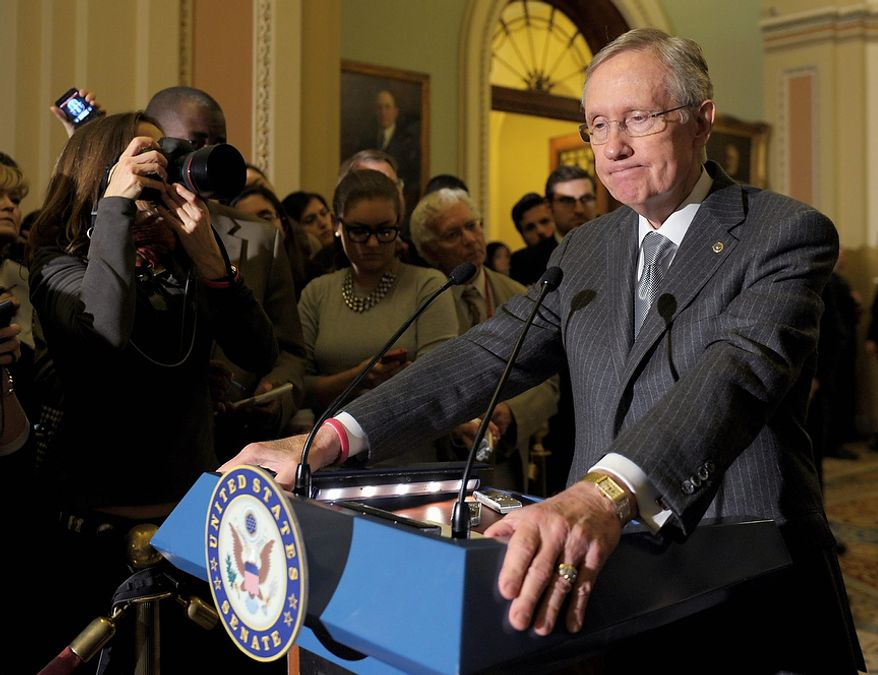 Senate Majority Leader Harry Reid of Nevada speaks to reporters following the Democratic policy luncheon on Capitol Hill in Washington, Tuesday, Dec. 18, 2012. (AP Photo/Susan Walsh)