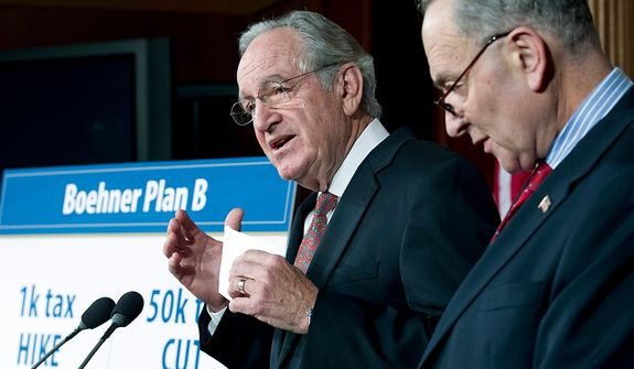 "Sen. Charles E. Schumer, New York Democrat, listens to Sen. Tom Harkin, Iowa Democrat, during a news conference about House Speaker John A. Boehner's proposal regarding the ""fiscal cliff,"" on Capitol Hill in Washington on Wednesday, Dec. 19, 2012. (AP Photo/Jose Luis Magana)"