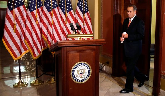 "House Speaker John A. Boehner, Ohio Republican, arrives to speak on the ""fiscal cliff"" negotiations on Capitol Hill in Washington on Wednesday, Dec. 19, 2012. (AP Photo/Jacquelyn Martin)"