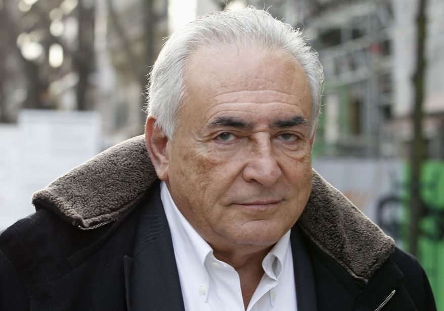 ** FILE ** Dominique Strauss-Kahn, former managing director of the International Monetary Fund, leaves his apartment building in Paris on Tuesday, Dec. 11, 2012. (AP Photo/Jacques Brinon)