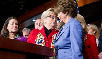 House Minority Leader Rep. Nancy Pelosi (D-Calif.) and Carolyn McCarthy (D-N.Y.) embrace during a news conference calling for a ban on high-capacity ammunition clips with fellow House Democrats in the House Visitors Center on Capitol Hill, Washington, D.C., Wednesday, Dec. 19, 2012. Rep. McCarthy's husband was killed and her son severely injured in a Long Island Rail Road commuter train shooting spree in 1993. (Andrew Harnik/The Washington Times)