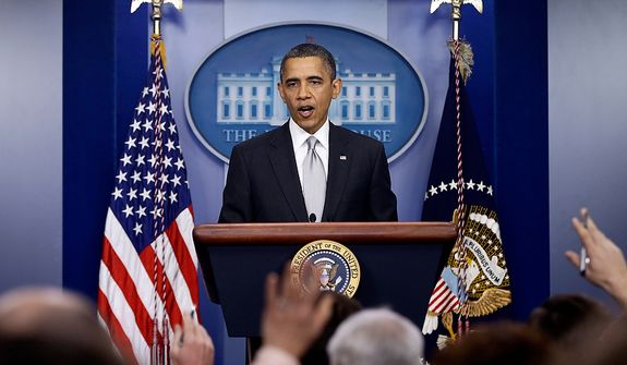 President Barack Obama takes questions from reporters, Wednesday, Dec. 19, 2012, at the White House in Washington. (AP Photo/Charles Dharapak)