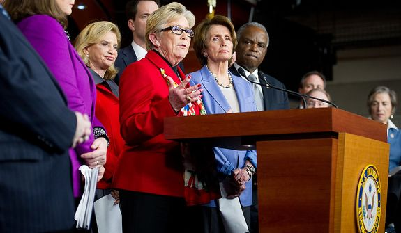 Carolyn McCarthy (D-N.Y.) is surrounded by her fellow House Democrats as she speaks at a news conference calling for a ban on high capacity ammunition clips following the Newtown, Conn., shooting massacre, in the House Visitors Center on Capitol Hill, Washington, D.C., Wednesday, December 19, 2012. Rep. McCarthy's husband was killed and her son severely injured in a Long Island Rail Road commuter train shooting spree in 1993. (Andrew Harnik/The Washington Times)