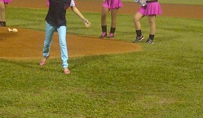 Victoria Cabrera, recovered now from major heart surgery in late August, throws out the first pitch for the Tigres de Aragua in Venezuela on Monday. Washington Nationals catcher Wilson Ramos helped Cabrera and her mother, Marfa Mata, raise the money for her surgery. (Photo courtesy of Marfa Mata)