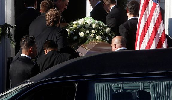 A coffin bearing the body of Victoria Soto is carried into Lordship Community Church before her funeral service, Wednesday, Dec. 19, 2012, in Stratford, Conn.  Soto was killed when a gunman forced his way into Sandy Hook Elementary School in Newtown, Dec. 14,  and opened fire, killing 26 people, including 20 children. (AP Photo/Jason DeCrow)