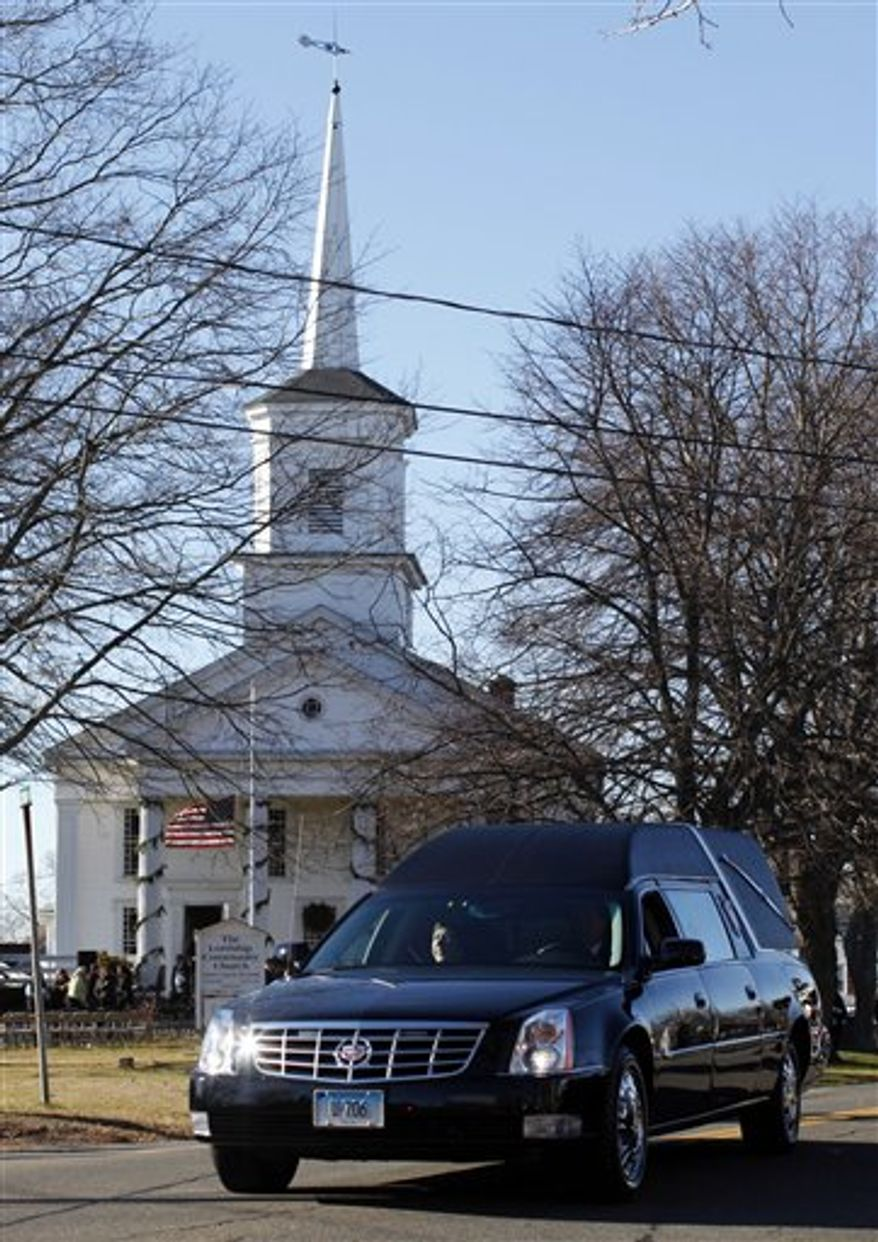 A hearse bearing the body of Victoria Soto drives past Lordship Community Church as it leaves after her funeral service, Wednesday, Dec. 19, 2012, in Stratford, Conn.  Soto was killed when Adam Lanza walked into Sandy Hook Elementary School in Newtown, Conn., Dec. 14, and opened fire, killing 26 people, including 20 children, before killing himself. (AP Photo/Jason DeCrow)