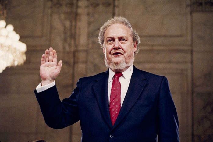 Judge Robert H. Bork, nominated by President Reagan to be an associate justice of the U.S. Supreme Court, is sworn before the Senate Judiciary Committee on Capitol Hill for his confirmation hearing on Sept. 15, 1987. (AP Photo/John Duricka)