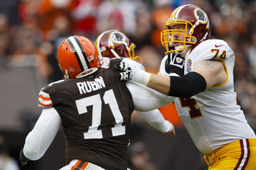 Washington Redskins tackle Tyler Polumbus (74) blocks Cleveland Browns defensive tackle Ahtyba Rubin (71) during an NFL football game in Cleveland, Sunday, Dec. 16, 2012. (AP Photo/Rick Osentoski)