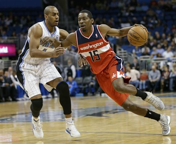 Washington Wizards shooting guard Jordan Crawford (15) drives past Orlando Magic's Arron Afflalo (4) during the first half of an NBA game on Wednesday, Dec. 19, 2012, in Orlando, Fla. (AP Photo/John Raoux)