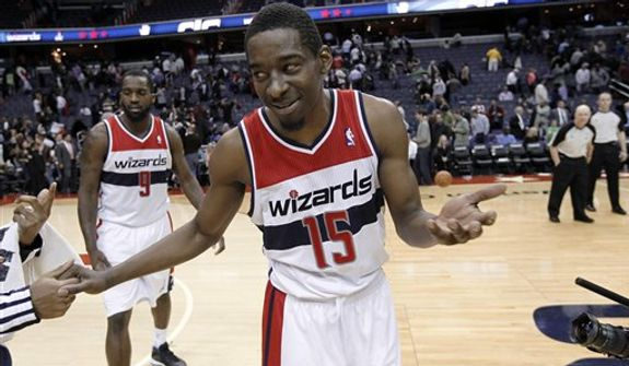 Washington Wizards guard Jordan Crawford (15) reacts as he talks with a member of the Atlanta Hawks after an NBA basketball game Tuesday, Dec. 18, 2012, in Washington. The Hawks won 100-95 in overtime. (AP Photo/Alex Brandon)