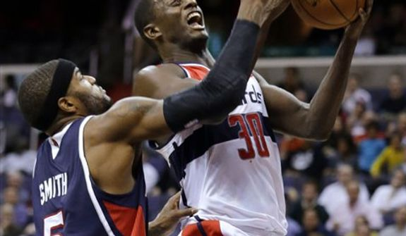 Washington Wizards center Earl Barron shoots as Atlanta Hawks forward Josh Smith defends during the second half of an NBA basketball game Tuesday, Dec. 18, 2012, in Washington. The Hawks won 100-95 in overtime. (AP Photo/Alex Brandon)