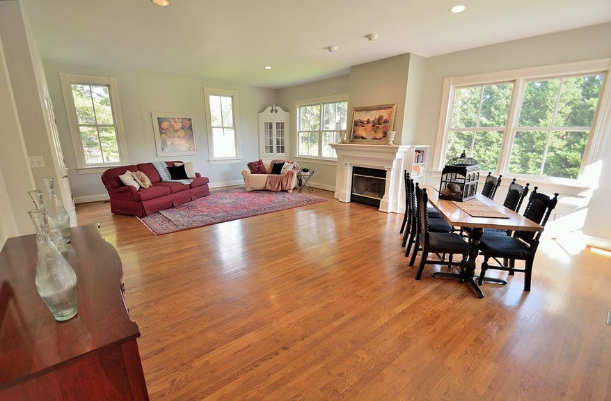 The home has hardwood flooring and high ceilings throughout the main and upper levels.