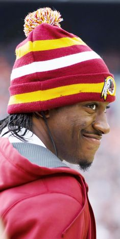 Redskins quarterback Robert Griffin III was able to plant on his injured right leg and deliver passes for the second straight day of practice. (Associated Press)