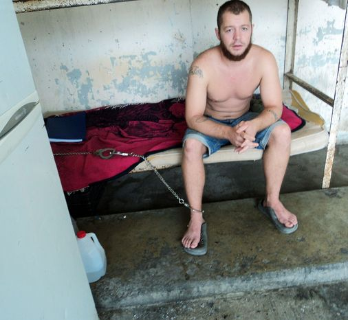 Former Marine Jon Hammar is shackled to his bunk in a prison in Matamoros, Mexico. The Iraq and Afghanistan combat veteran (official 2003 portrait at top) was arrested at the border while trying to declare a prized heirloom gun (below) he was carrying on a surfing trip. He reportedly is no longer in chains. (Associated Press)