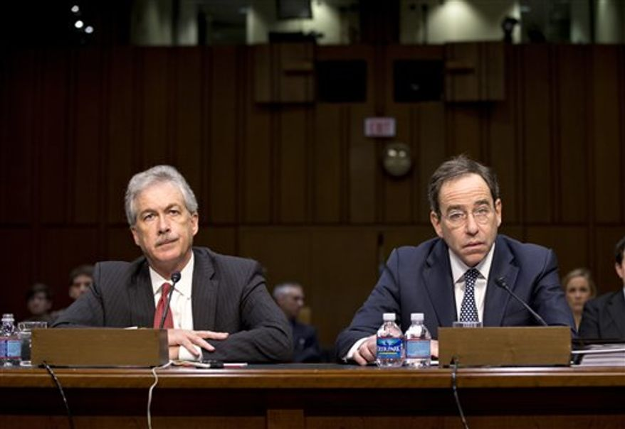 The Senate Foreign Relations Committee holds a hearing with Deputy Secretary of State William J. Burns (left), who is in charge of policy, and Deputy Secretary of State Thomas Nides (right), who is in charge of management, on Capitol Hill in Washington on Thursday, Dec. 20, 2012. The two testified regarding an independent review panel's report that said serious bureaucratic mismanagement was responsible for inadequate security at the mission in Benghazi, Libya, where the U.S. ambassador and three other Americans were killed on Sept. 11. (AP Photo/J. Scott Applewhite)