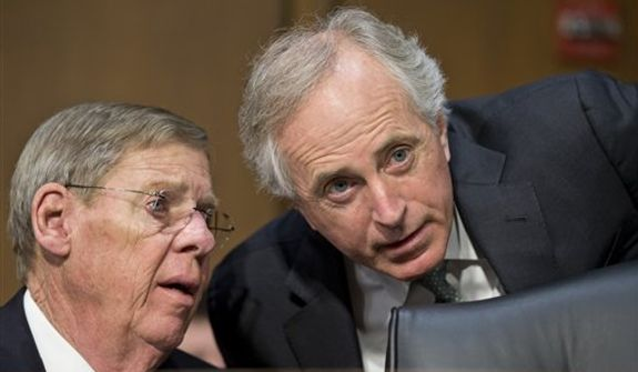 Sen. Bob Corker, R-Tenn., right, confers with Sen. Johnny Isakson, R-Ga., left, as they listen to testimony from State Department officials after an independent review panel said this week that serious bureaucratic mismanagement was responsible for inadequate security at the mission in Benghazi, Libya, where the U.S. ambassador and three other Americans were killed on Sept. 11, on Capitol Hill in Washington, Thursday, Dec. 20, 2012. Deputy Secretary of State Thomas Nides, who is in charge of management, and State Department Deputy Secretary of State William Burns, who is in charge of policy, appeared in place of Secretary of State Hillary Rodham Clinton who had been scheduled to testify but canceled after fainting and sustaining a concussion last week.  (AP Photo/J. Scott Applewhite)