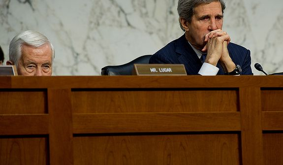Sen. John Kerry, right, chair of the Senate Foreign Relations Committee, listens to testimony during a hearing Thursday, Dec. 20, 2012 on the Benghazi attack. William J. Burns, deputy secretary of state, and Thomas R. Nides, deputy secretary of  state for management and resources, were witnesses. (Barbara L. Salisbury/The Washington Times)