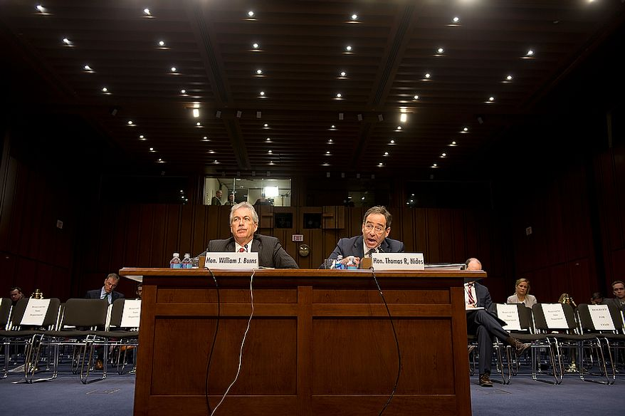 William J. Burns, left, deputy secretary of state, and Thomas R. Nides, deputy secretary of  state for management and resources, speak before the Senate Foreign Relations Committee at a hearing Thursday, Dec. 20, 2012 on the Benghazi attack. (Barbara L. Salisbury/The Washington Times)